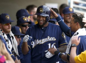 Mar 11, 2016; Phoenix, AZ, USA; Milwaukee Brewers right fielder Domingo Santana (16) hits a solo homerun against the Texas Rangers in the first inning during a spring training game at Maryvale Baseball Park. Mandatory Credit: Rick Scuteri-USA TODAY Sports