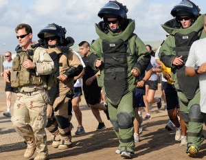110402-F-XM360-212 CAMP LEMONNIER, Djibouti (April 2, 2011) -- U.S. Navy Lieutenant Junior Grade John Maurus (left), Explosive Ordnance Disposal Team 11 leader, runs with members of his team during the EOD Memorial five kilometer run on April 2. The run was organized by the EOD team to raise awareness of the sacrifice of EOD technicians worldwide, and bring attention to the EOD Memorial Foundation, a non-profit organization established on behalf of wounded or deceased EOD technicians and their families. (AFRICOM photo by U.S. Air Force Master Sgt. Dawn M. Price)