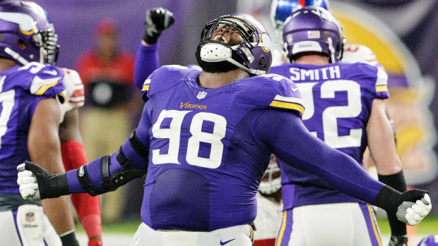 0d9d26924 Minnesota Vikings defensive tackle Linval Joseph shouts in victory after  stopping the New York Giants on a third down in the second quarter at U.S.  Bank ...