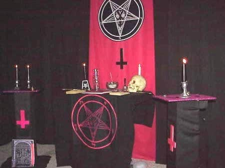A Church of Satan altar. Are those crosses there in honor of St. Peter? No, they represent the inversion of Christianity.