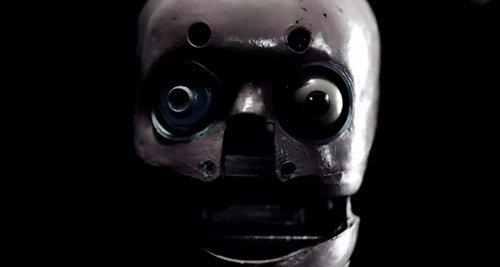 Una cara espeluznante con un ojo.  Agenda Illuminati.