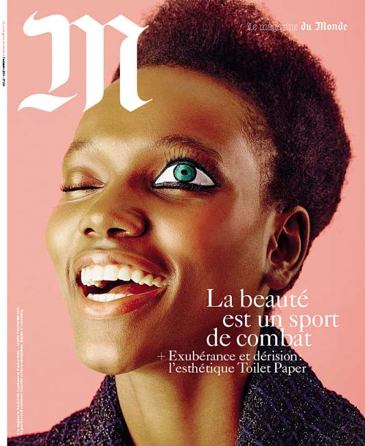 Francês Le Monde Revista apresenta um grande, gritante, sinal de um olho.