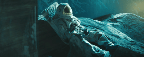 The video begins with a dead astronaut on a remote planet.