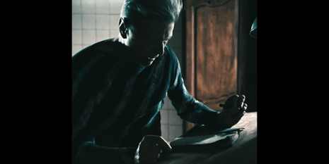 With theatrical maneurisms, this Bowie begins writing feverishly inside a book, as if animated by a higher force. Is this the source of Bowie's inspiration throughout the years?