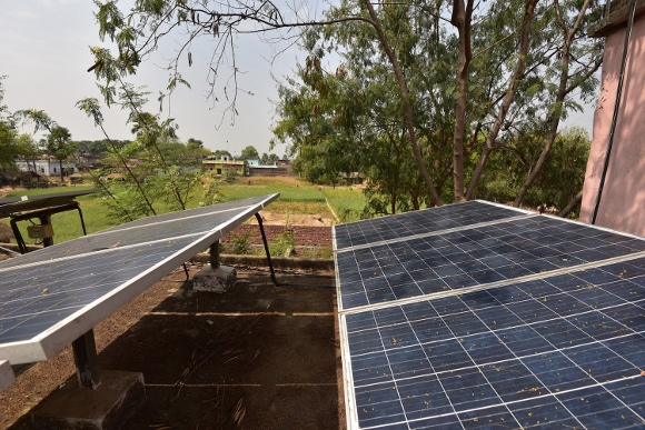 Solar panels and the fields of Dharnai.