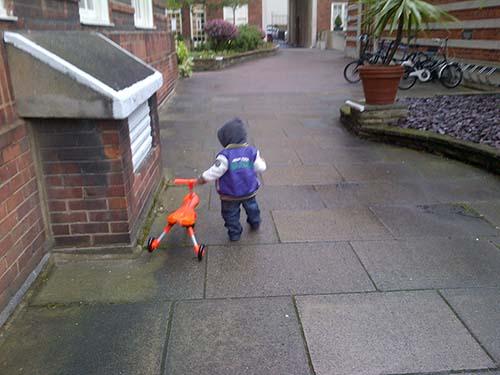 vika raskina - boy walking with toy