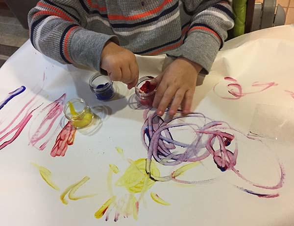 vika raskina - boy painting with hands