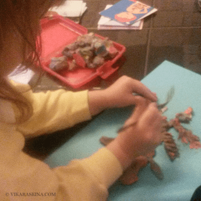 vika raskina - girl working on handmade toy