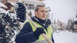 Man removing snow in winter