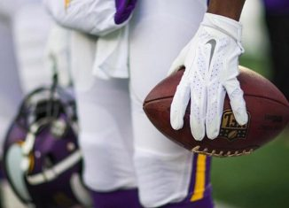 Teddy Bridgewater Holding Ball 2015