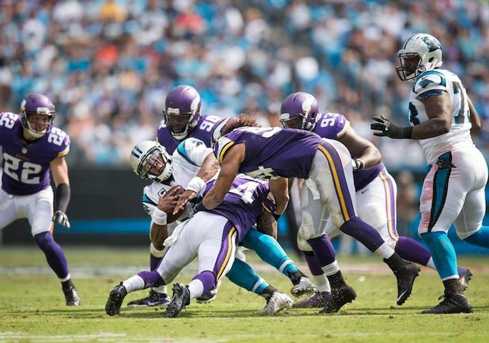 The Vikings defense smothered Panthers quarterback Cam Newton like he was a Juicy Luicy. (Vikings.com)