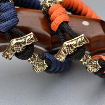 Фото двухцветный паракордовый браслет с застежкой молот Тора