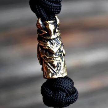 Фото чёрный темляк из паракорда для ножа с бусиной Велес
