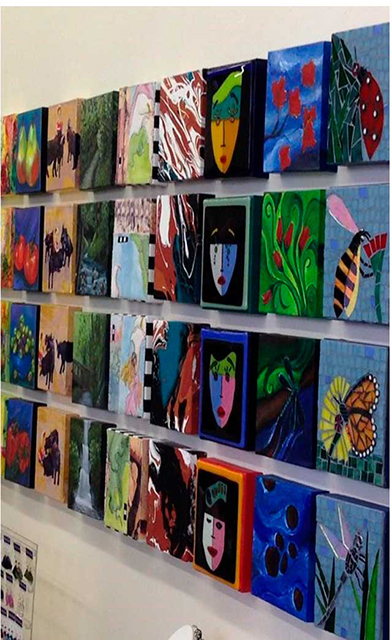 Image of Art adoption wall with art entries hung