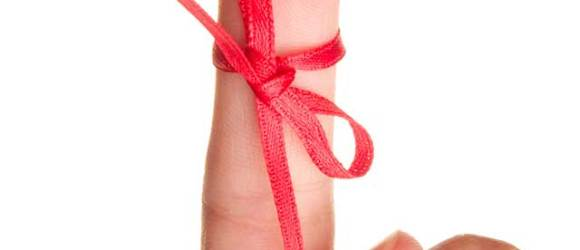 Image of a hand with a red ribbon around the forefinger as a reminder
