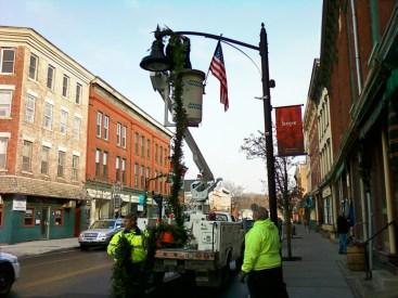 Hanging holiday garlands Main street