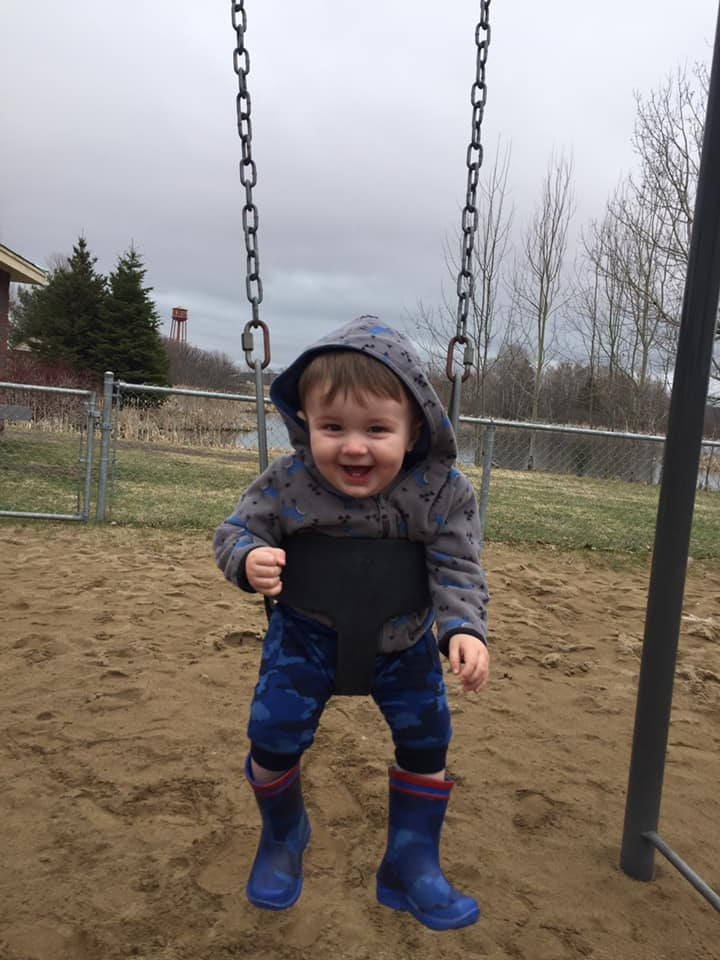 Deacon enjoying a Spring day at the playground