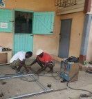 Marlon Wayne (L) and Rawle Anthony Johnson (R) welding pieces of metal together