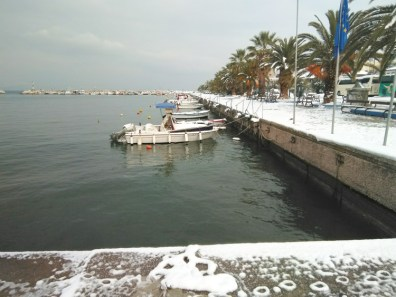 Snow in harbor of Limenas, Thassos