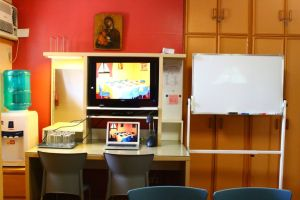 """View of Water Dispenser, 30"""" LED TV with Laptop and Whiteboard"""