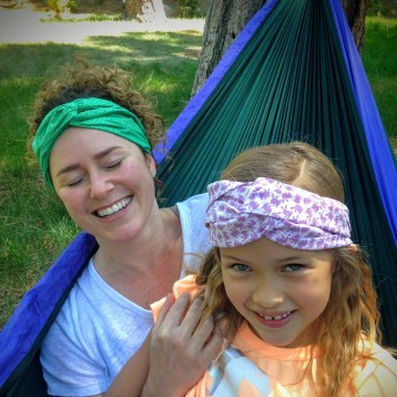 Just two headband-model babe peas in a babe pea pod.