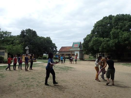 Shanniqua walkin' the kids through the relay race.