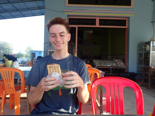 Ben about to graciously share his rice-coconut waffle with lil ole me.