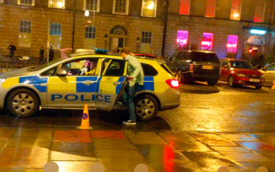 VIDEO: Incredibly drunk man in Scotland thought he could use a cop car as a taxi