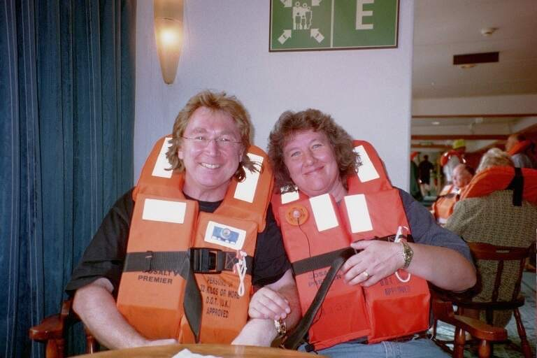 Photograph of the author and his wife in bright orange lifejackets