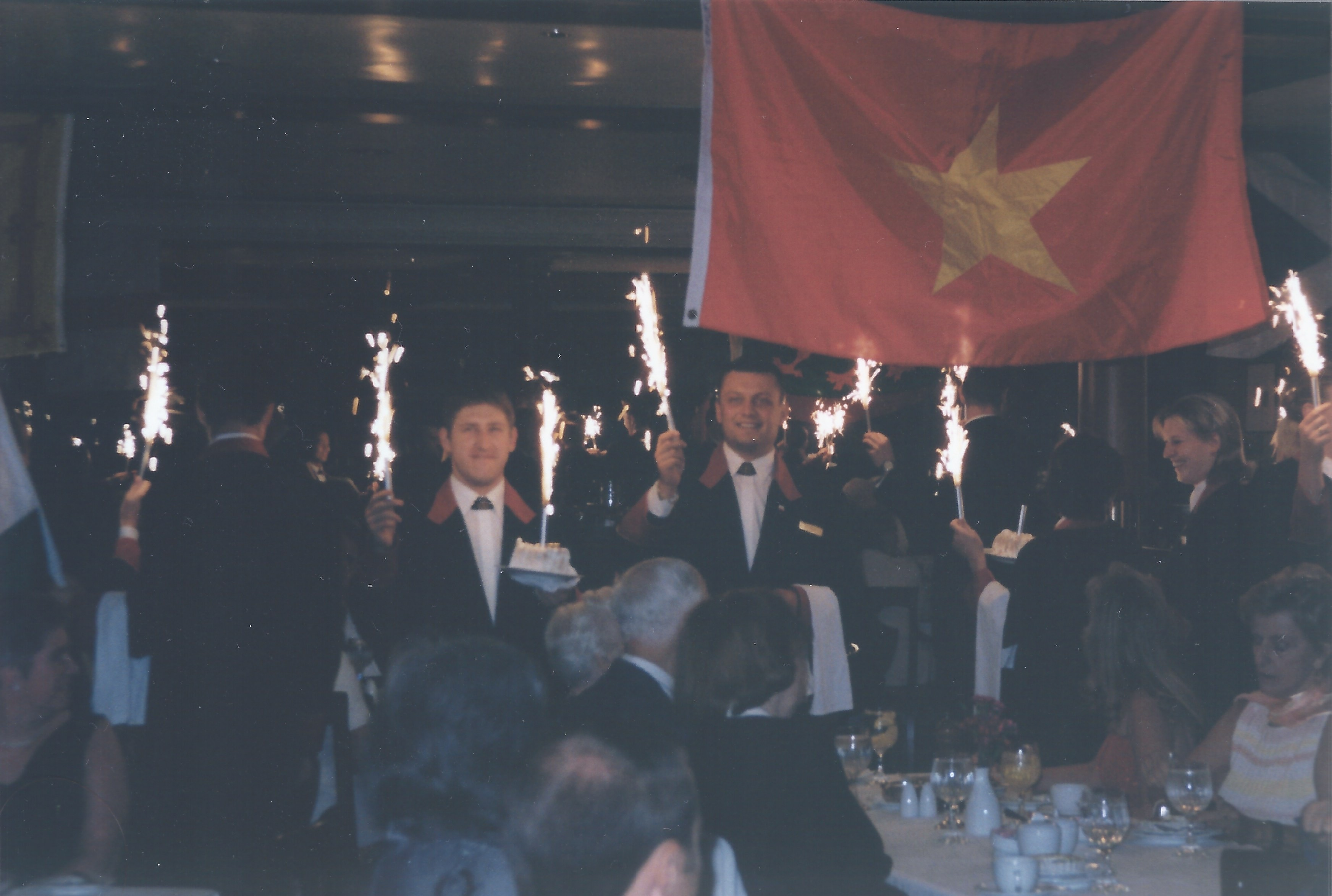 Photograph of the two waiters during a celebration