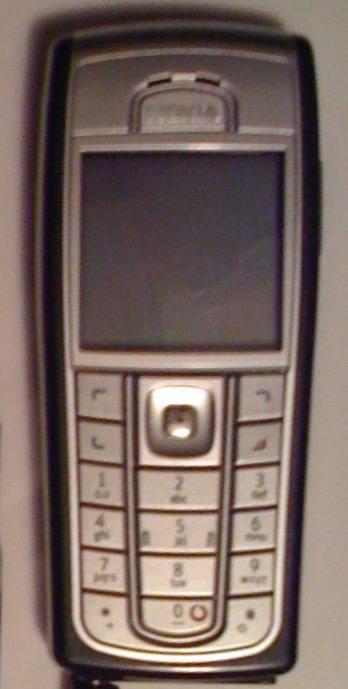 An image of a simple mobile phone with small dot matrix type screen
