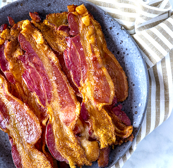 cooked bacon in a bowl