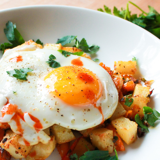 breakfast potatoes in bowl with egg
