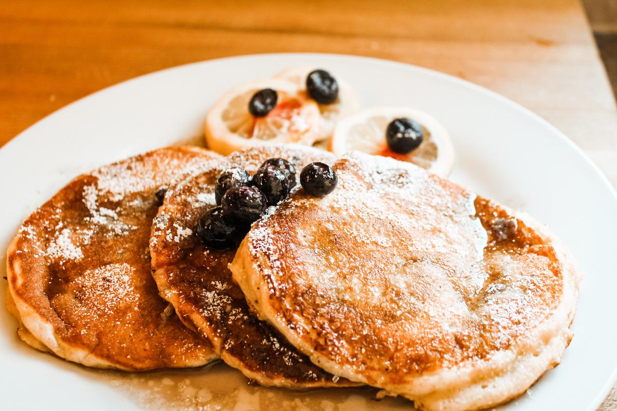 blueberry lemon pancakes on a plate