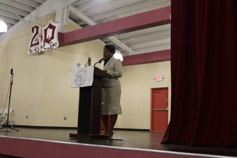 Attorney Su-Layne Walker addresses the audience at ACJHS