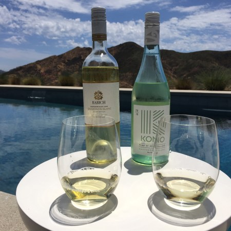 Bottle and glass of Babich Sauvignon Blanc (left) and Kono Sauvignon Blanc (right).