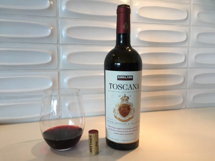 Bottle and glass of Kirkland Signature Toscana.