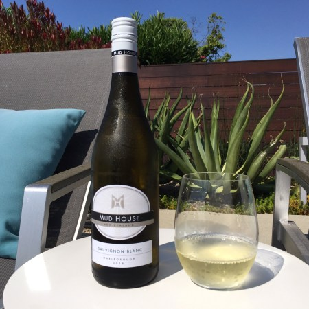 Bottle and glass of Mud House New Zealand Sauvignon Blanc