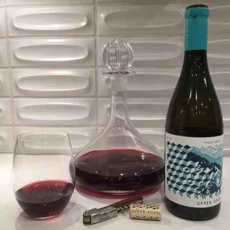 Upper Eden 2018 Pinot Noir in a glass and decanter, bottle shown