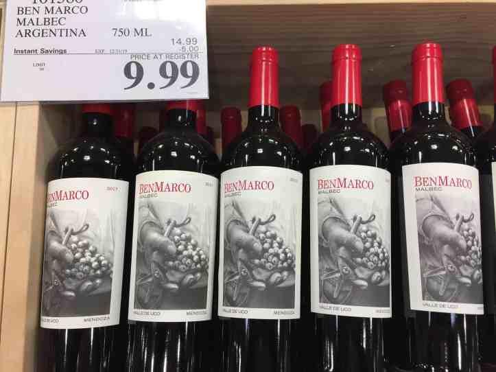 Bin of BenMarco Malbec at Costco showing $9.99 price per bottle.