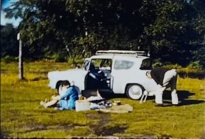 A thumbnail from a standard 8mm film of a couple taking a trip to Burnham Beeches in their Ford Anglia in the 1960s