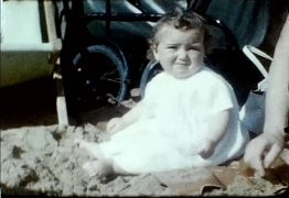 A still picture from a vintage home movie showing a family beach holiday in 1955