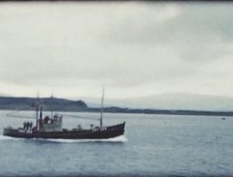 A still image of a boat which was taken from a vintage home movie of Oban in Scotland in 1958