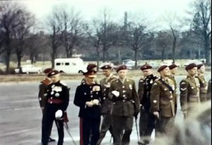 A still shot from a vintage home movie showing the opening ceremony of a new barracks for the Parachute Regiment in 1965
