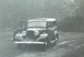 A still from a family home movie from the 1930s showing their car