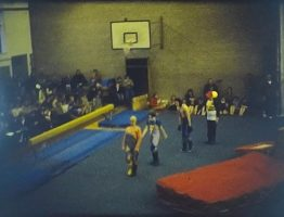 A still image from a Vintage Home Movie shot at a gymnastics display on Super 8 film.