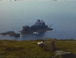 A still image showing a crop of rocks at Land's End from a vintage home movie taken in the 1960s