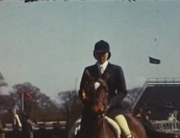 A still image from a vintage home movie shot at the Hickstead showjumping ground in the 1960s