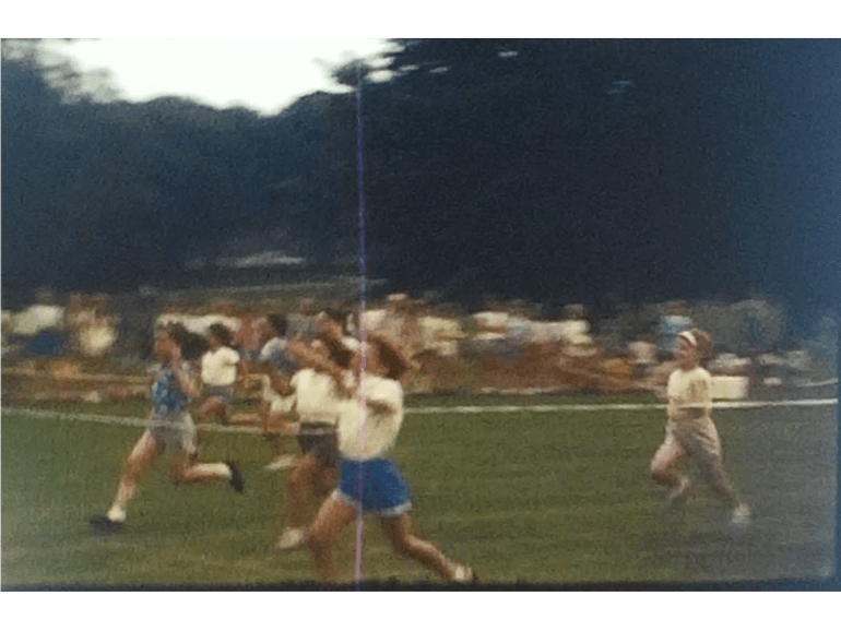 A Still image showing the finish line of a school sports day filmed in 1967