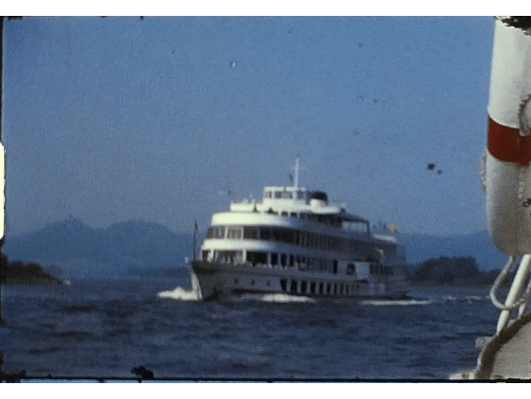 A Still image from a vintage home movie of a river trip on the Rhine river in Germany from the 1970s